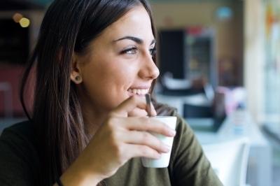 0388-beautiful_girl_drinking_coffee_sitting_indoor_in_urban_cafe.jpg