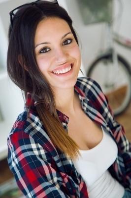 0445-beautiful_young_woman_looking_at_camera_at_home.jpg