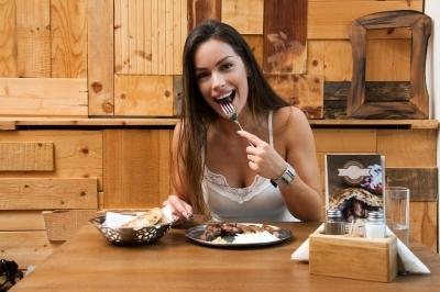 0450-beautiful_woman_eating_traditional_balkan_dish.jpg