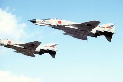 0517-f-4ej_(344&321)_of_302_sqn_fly_over_misawa_air_base.jpg