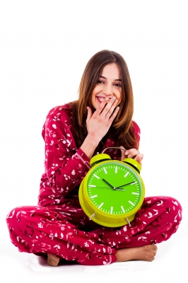 0168-teenager_sitting_with_alarm_clock.jpg