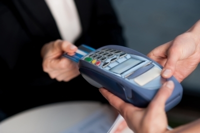 0385-corporate_lade_swiping_her_card_to_pay.jpg