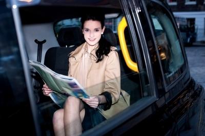 0385-female_passenger_reading_newspaper_inside_taxi.jpg