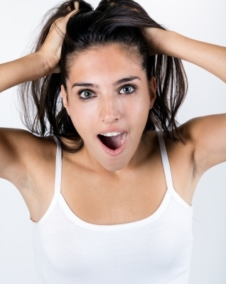 0449-young_surprised_woman_holding_her_face.jpg